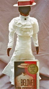 Toni Morrison's Beloved posing with book cover by Omnidoll 1996. Photo by Omnidoll 1996.