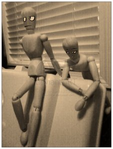 Two wooden artist mannequins relaxing together, with bored facial features superimposed on the photo. From http://bluebead.deviantart.com/art/Mannequin-003-Chill-n-69577475.