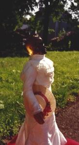 Beloved in yard holding hat by Omnidoll 1996.