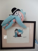 Mr. Squid by Omnidoll, from Piranha Club, posing with original art by the cartoonist Bud Grace.