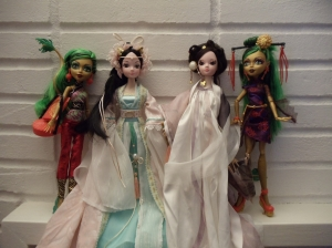 "L to R: Mattel Monster High Scaremester ""Jinafire Long"" Dragon Character (2014),  Kurhn ""Dragon Fairy Princess (Goddess)"" ~2008, Kurhn ""White Snake Fairy"" ~2008, Mattel ""Scaris City of Frights Jinafire Long"" (2013)."